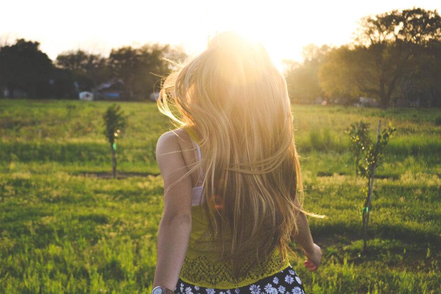 Woman walking sunlight